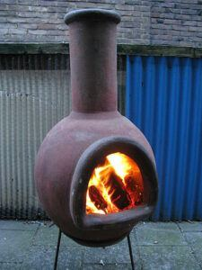 wood burning chiminea provides outdoor warmth